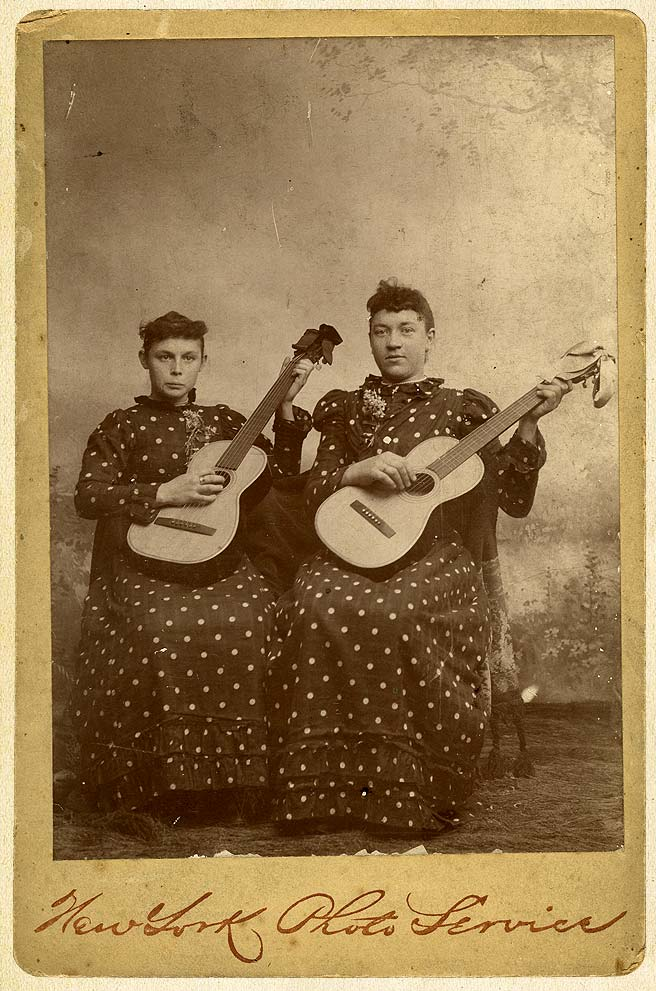 Two Women With Guitars